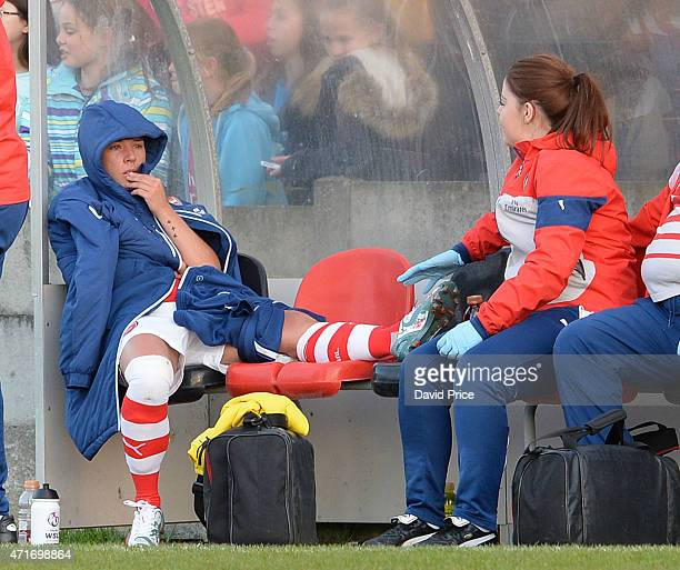 Jordan Nobbs of Arsenal Ladies comforted by Arsenal Physio Mary Shiels after coming off injured during the match between Chelsea Ladies and Arsenal...