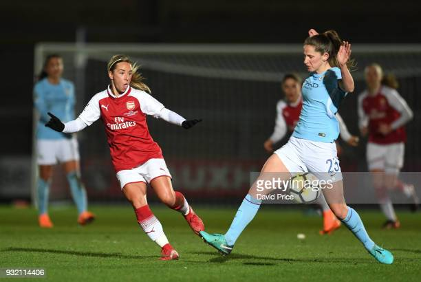 Jordan Nobbs of Arsenal passes the ball under pressure from Abbie McManus of Man City during the match between Arsenal Women and Manchester City...
