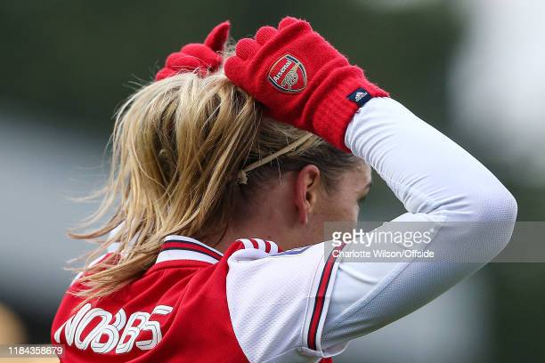 Jordan Nobbs of Arsenal tightens her ponytail while wearing Arsenal wooly gloves during the Barclays FA Women's Super League match between Arsenal...