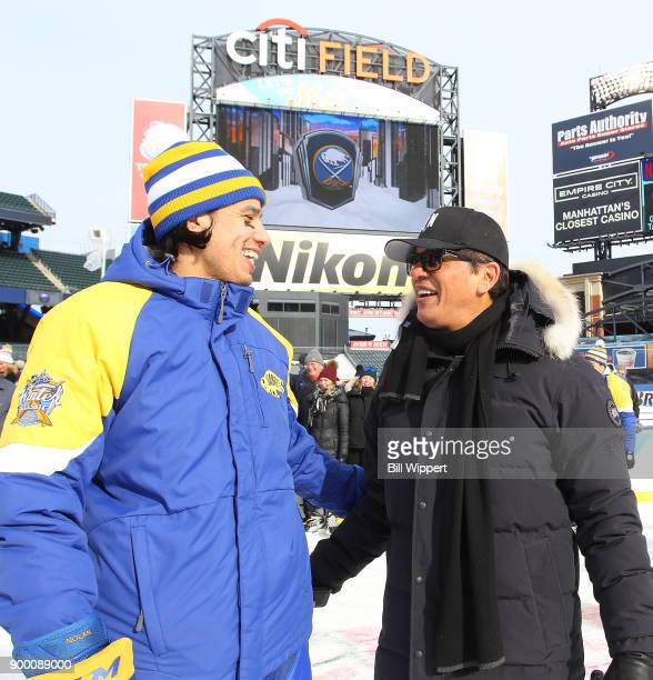 Jordan Nolan of the Buffalo Sabres has a laugh with his father Ted at Practice Day for the 2018 Bridgestone NHL Winter Classic at Citi Field on...
