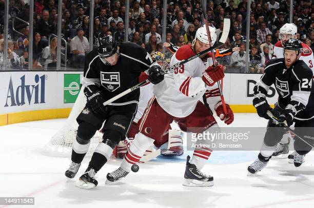Jordan Nolan of the Los Angeles Kings battles for the puck against Derek Morris of the Phoenix Coyotes in Game Four of the Western Conference Finals...