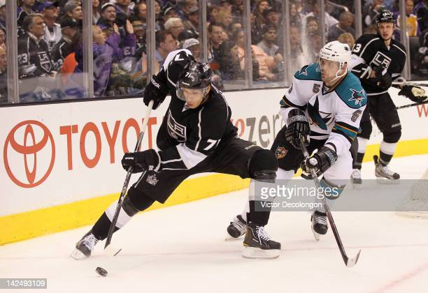Jordan Nolan of the Los Angeles Kings controls the puck in the corner as Colin White of the San Jose Sharks gets in position to defend the play in...