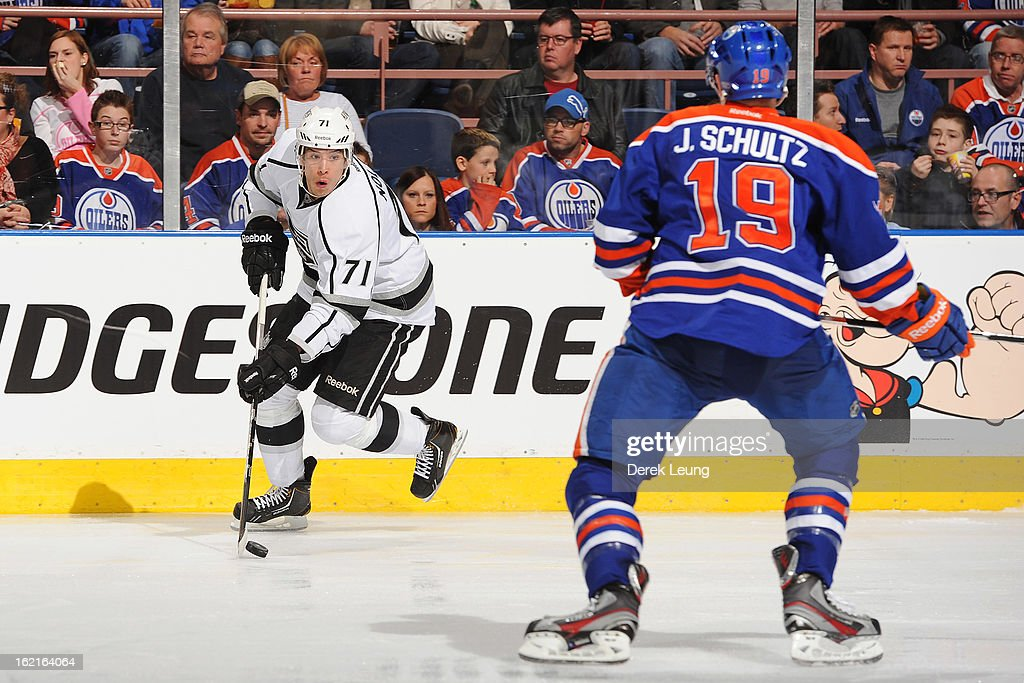 Jordan Nolan #71 of the Los Angeles Kings skates against Justin Schultz #19 of the Edmonton Oilers during an NHL game at Rexall Place on February 19, 2013 in Edmonton, Alberta, Canada. The Los Angeles Kings won 3-1.