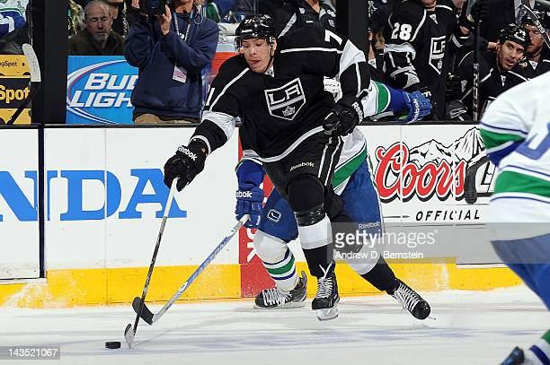 Jordan Nolan of the Los Angeles Kings skates with the puck against the Vancouver Canucks in Game Four of the Western Conference Quarterfinals during...