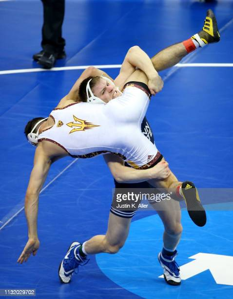 Jordan Nolf of the Penn State Nittany Lions attempts a body slam on Christian Pagdilao of the Arizona State Sun Devils in the 157 lbs weight class...