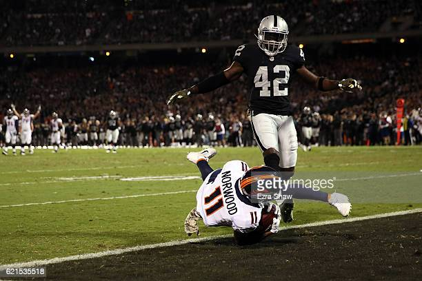 Jordan Norwood of the Denver Broncos catches a touchdown pass from Trevor Siemian during the second quarter against the Oakland Raiders at...
