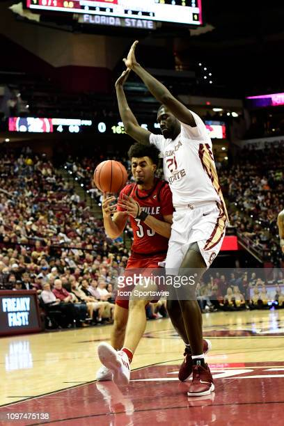 Jordan Nwora forward Louisville Cardinals loses control of the basketball while working against Christ Koumadje center Florida State University...
