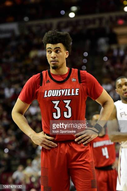 Jordan Nwora forward Louisville Cardinals stands on the court during a break in the basketball game with the Florida State Seminoles in an Atlantic...