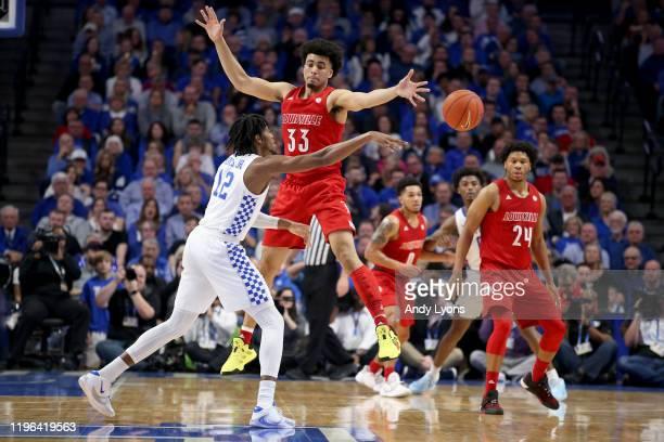 Jordan Nwora of the Louisville Cardinals defends Keion Brooks Jr of the Kentucky Wildcats at Rupp Arena on December 28, 2019 in Lexington, Kentucky.