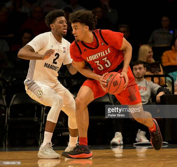 Jordan Nwora of the Louisville Cardinals dribbles in a game against the Marquette Golden Eagles during the NIT Season TipOff at the Barclays Center...