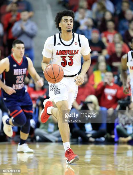 Jordan Nwora of the Louisville Cardinals dribbles the ball against the Robert Morris Colonials at KFC YUM Center on December 21 2018 in Louisville...