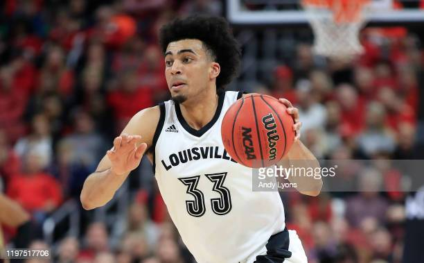 Jordan Nwora of the Louisville Cardinals dribbles the ball against the Florida State Seminoles at KFC YUM Center on January 04 2020 in Louisville...