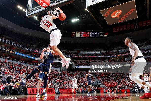 Jordan Nwora of the Louisville Cardinals dunks against the Pittsburgh Panthers in the second half of the game at KFC YUM Center on January 26 2019 in...