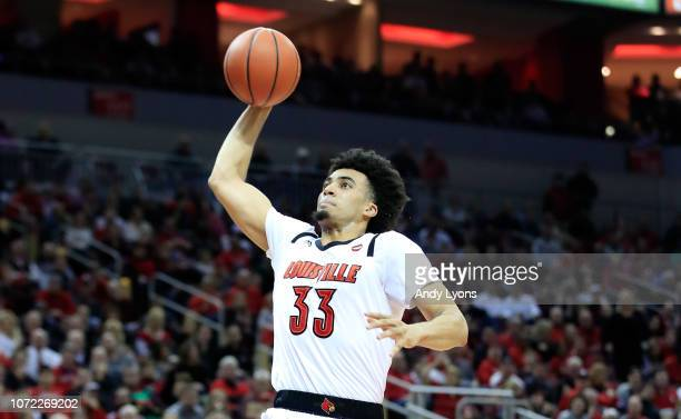 Jordan Nwora of the Louisville Cardinals dunks the ball against the Lipscomb Bisons at KFC YUM Center on December 12 2018 in Louisville Kentucky