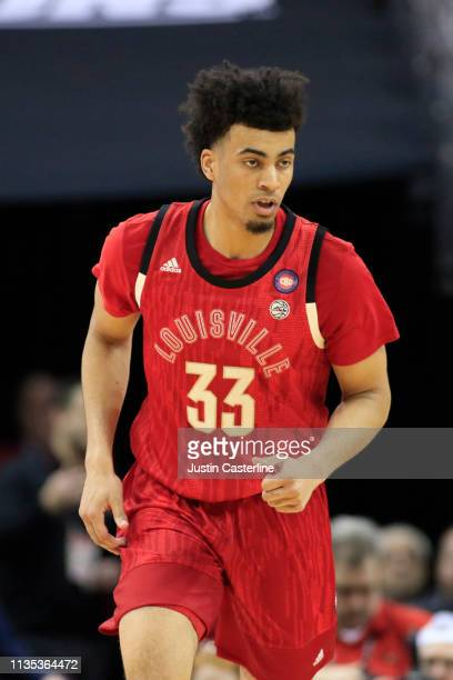 Jordan Nwora of the Louisville Cardinals in action in the game against the Virginia Cavaliers during the first half at KFC YUM Center on February 23...