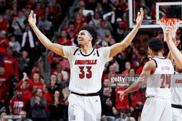 Jordan Nwora of the Louisville Cardinals reacts after a dunk against the Pittsburgh Panthers in the second half of the game at KFC YUM Center on...
