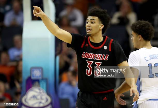 Jordan Nwora of the Louisville Cardinals reacts after a play against the North Carolina Tar Heels during their game in the quarterfinal round of the...