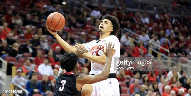 Jordan Nwora of the Louisville Cardinals shoots the ball against the Nicholls State Colonels at KFC YUM Center on November 8 2018 in Louisville...
