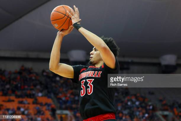 Jordan Nwora of the Louisville Cardinals shoots the ball against the Syracuse Orange during the first half at the Carrier Dome on February 20 2019 in...