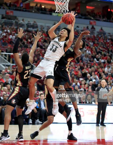 Jordan Nwora of the Louisville Cardinals shoots the ball against the Florida State Seminoles at KFC YUM Center on January 04 2020 in Louisville...