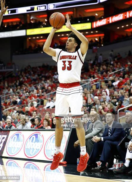 Jordan Nwora of the Louisville Cardinals shoots the ball against the Siena Saints during the game at KFC YUM Center on December 6 2017 in Louisville...