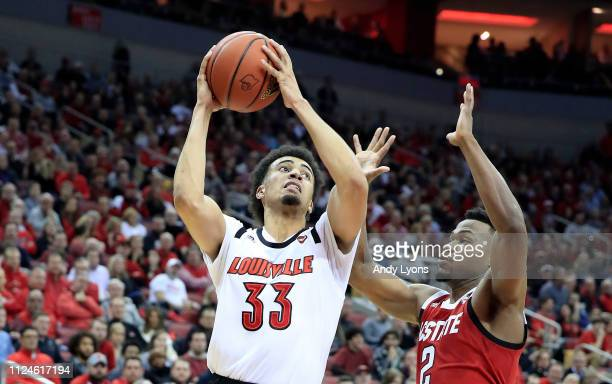 Jordan Nwora of the Louisville Cardinals shoots the ball during the 8477 win over the North Carolina State Wolfpack at KFC YUM Center on January 24...