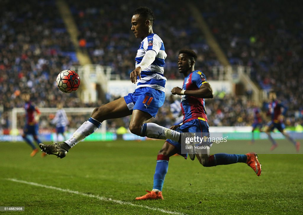 Jordan Obita of Reading beats Wilfried Zaha of Crystal Palace to the ball during the Emirates FA Cup sixth round match between Reading and Crystal Palace at Madejski Stadium on March 11, 2016 in Reading, England.