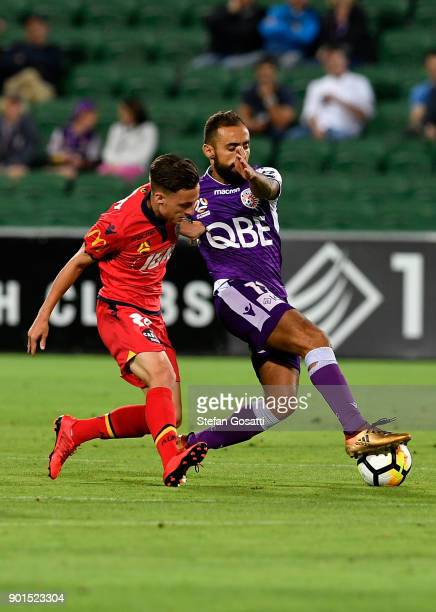 Jordan O'Doherty of Adelaide and Diego Castro of the Glory compete for the ball during the round 14 ALeague match between the Perth Glory and...