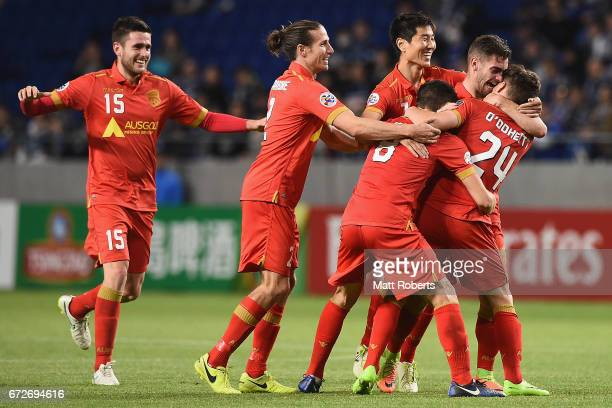 Jordan O'Doherty of Adelaide United celebrates scoring a goal with team mates during the AFC Champions League Group H match between Gamba Osaka v...