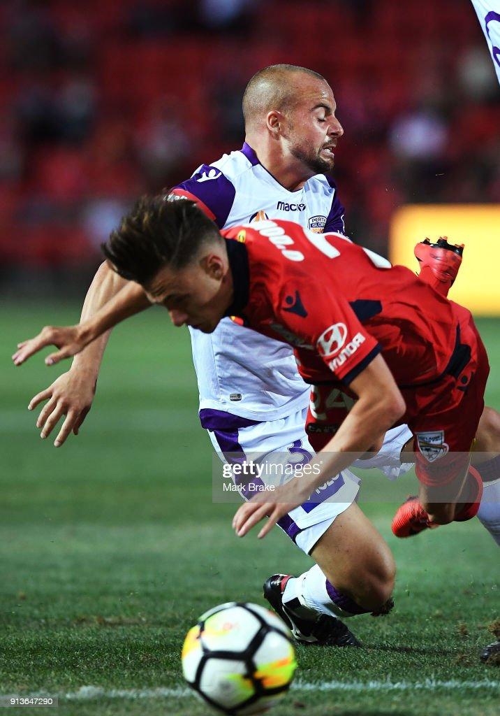 Jordan O'Doherty of Adelaide United is fouled by Marc Warren of Perth Glory during the round 19 A-League match between Adelaide United and the Perth Glory at Coopers Stadium on February 3, 2018 in Adelaide, Australia.