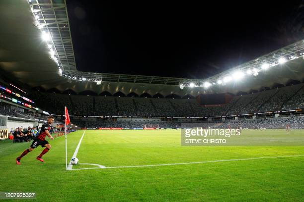 Jordan O'Doherty of the Wanderers takes a corner kick in an empty Bankwest Stadium, shuttered from fans due to the COVID-19 coronavirus outbreak,...