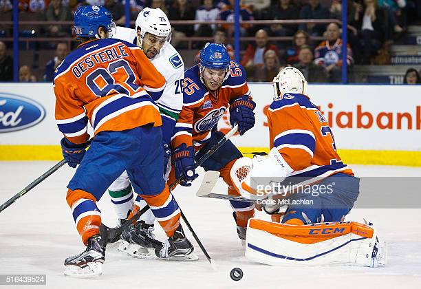 Jordan Oesterle Mark Letestu and goaltender Cam Talbot of the Edmonton Oilers defend the net against Emerson Etem of the Vancouver Canucks on March...