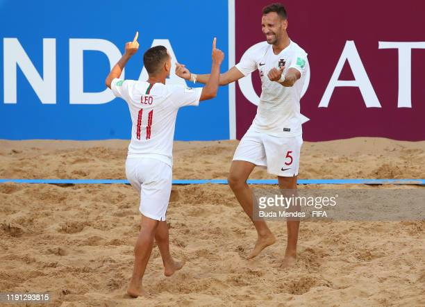 Jordan of Portugal celebrates with teammate Leo Martins after scoring his team's fourth goal during the FIFA Beach Soccer World Cup Paraguay 2019...