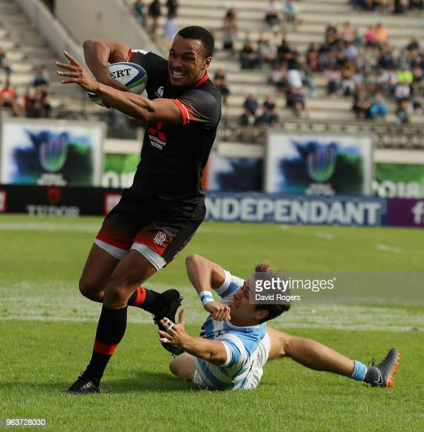 Jordan Olowofela of England breaks clear to score a try during the World Rugby U20 Championship match between England and Argentina at Stade...