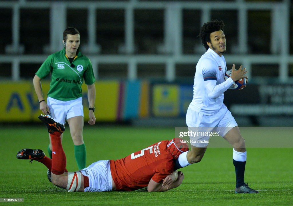 Jordan Olowofela of England is tackled by Jack Pope of Wales during the RBS Under 20's Six Nations match between England U20 and Wales U20 at Kingston Park on February 9, 2018 in Newcastle upon Tyne, England.