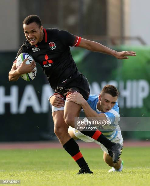 Jordan Olowofela of England is tackled by Mateo Carreras during the World Rugby U20 Championship match between England and Argentina at Stade...