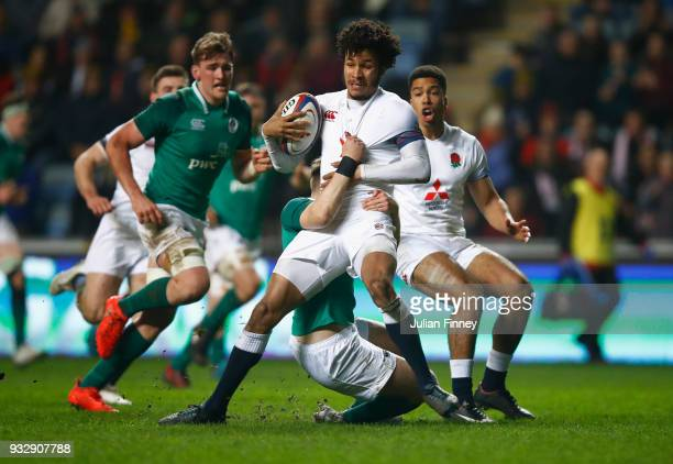 Jordan Olowofela of England is tackled by Michael Silvester of Ireland during the Natwest U20's Six Nations match between England U20 and Ireland U20...