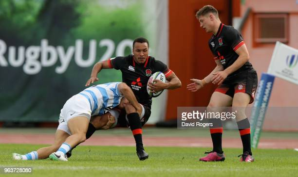 Jordan Olowofela of England is tackled during the World Rugby U20 Championship match between England and Argentina at Stade d'Honneur du Parc des...