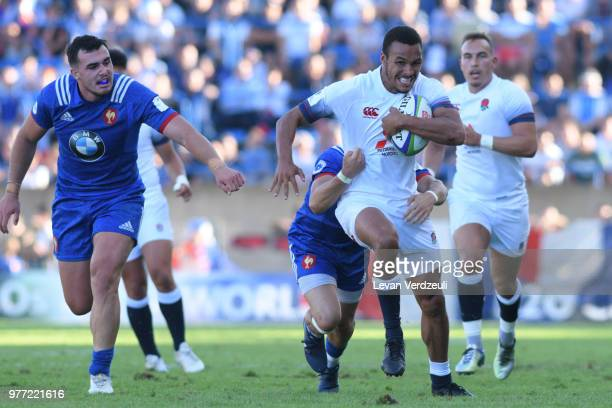 Jordan Olowofela of Enland runs with balll during the World Rugby Under 20 Championship Final between England and France on June 17 2018 in Beziers...