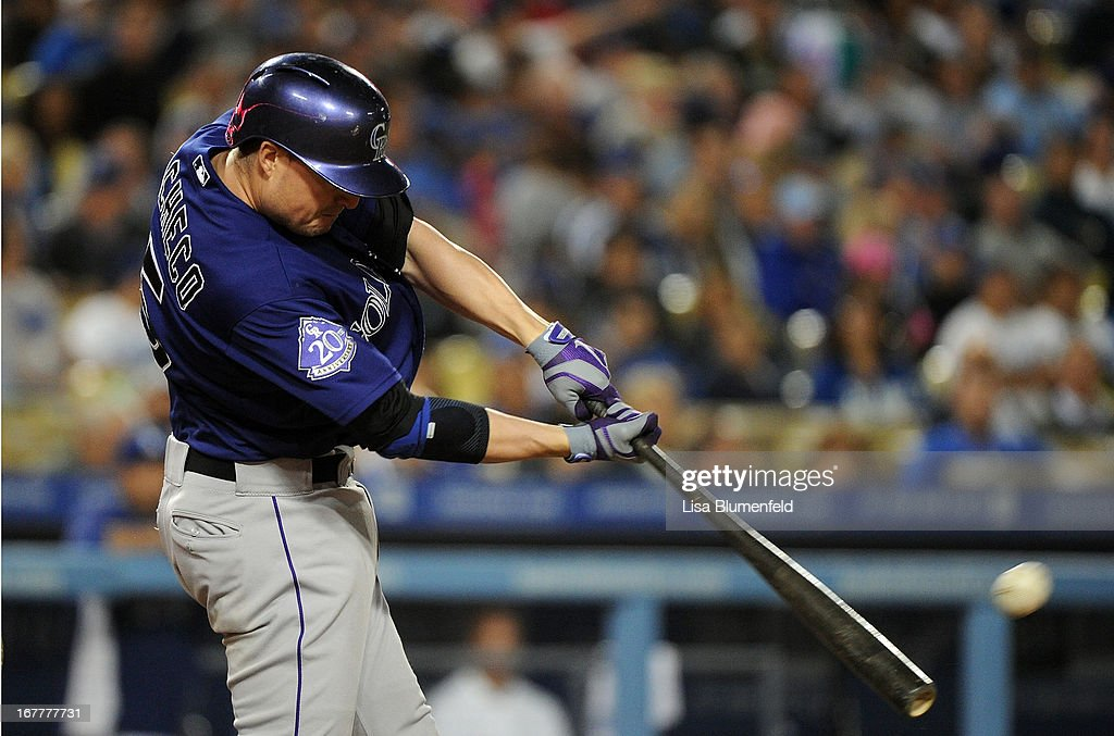 Jordan Pacheco #15 of the Colorado Rockies hits a two RBI ground-rule double in the fourth inning against the Los Angeles Dodgers at Dodger Stadium on April 29, 2013 in Los Angeles, California.