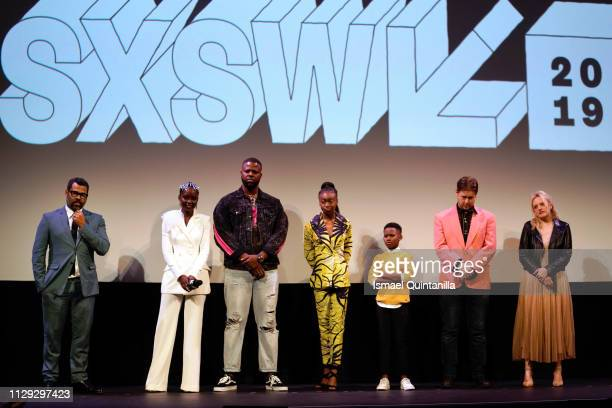 "Jordan Peele, Lupita Nyong'o, Winston Duke, Shahadi Wright Joseph, Evan Alex, Tim Heidecker, and Elisabeth Moss speak onstage the ""Us"" Premiere..."