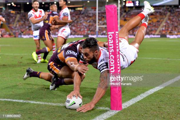 Jordan Pereira of the Dragons scores a try during the round 3 NRL match between the Brisbane Broncos and the St George Illawarra Dragons at Suncorp...