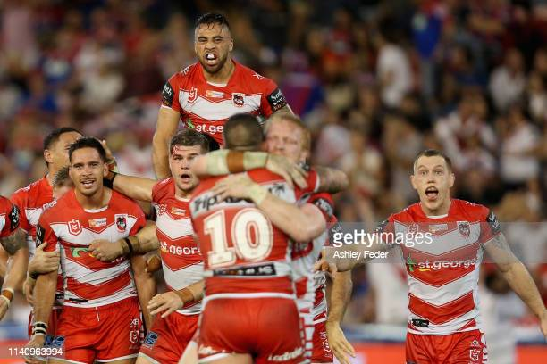Jordan Pereira of the St George Illawarra Dragons celebrates the win with team mates during the round four NRL match between the Newcastle Knights...
