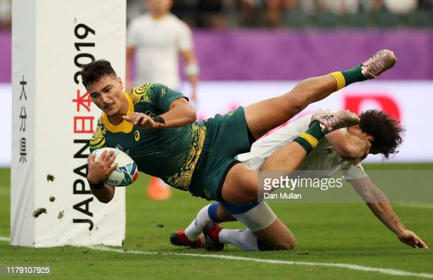 Jordan Petaia of Australia dives to score his side's second try during the Rugby World Cup 2019 Group D game between Australia and Uruguay at Oita...