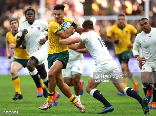 Jordan Petaia of Australia runs with the ball as he attempts to fend off Owen Farrell of England during the Rugby World Cup 2019 Quarter Final match...