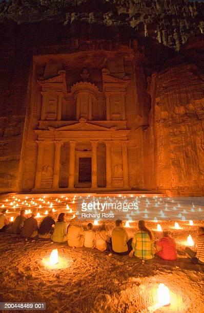 jordan, petra, tourists at ancient city ruins of edom at night - jordanian workforce stock pictures, royalty-free photos & images