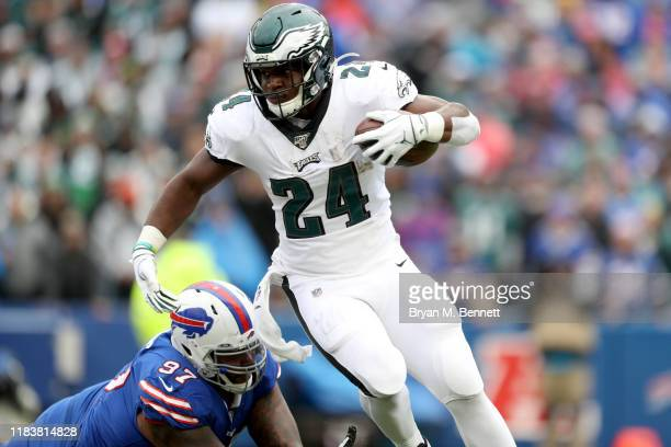 Jordan Phillips of the Buffalo Bills attempts to tackle Jordan Howard of the Philadelphia Eagles during the second quarter of an NFL game at New Era...