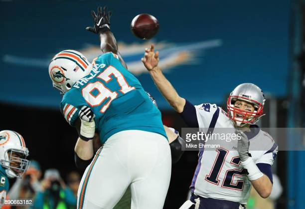 Jordan Phillips of the Miami Dolphins attempts to block a pass by Tom Brady of the New England Patriots in the third quarter at Hard Rock Stadium on...