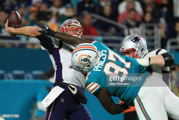 Jordan Phillips of the Miami Dolphins blocks a pass attempt by Tom Brady of the New England Patriots in the fourth quarter at Hard Rock Stadium on...