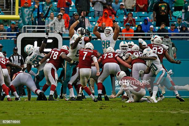 Jordan Phillips of the Miami Dolphins blocks the point after touchdown kick by Chandler Catanzaro of the Arizona Cardinals on December 11 2016 at...